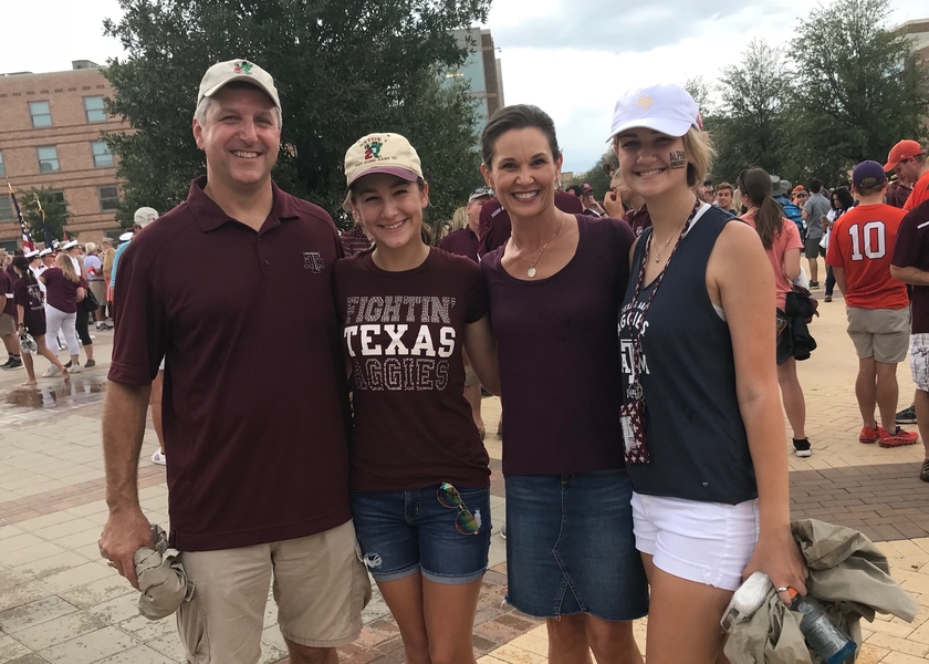 A family wearing Texas A&M attire at a football game