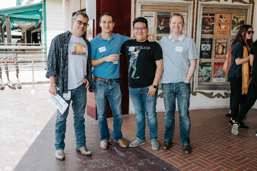 Four males posing for a photo outside of the Majestic Theater on Lower Greenville in Dallas