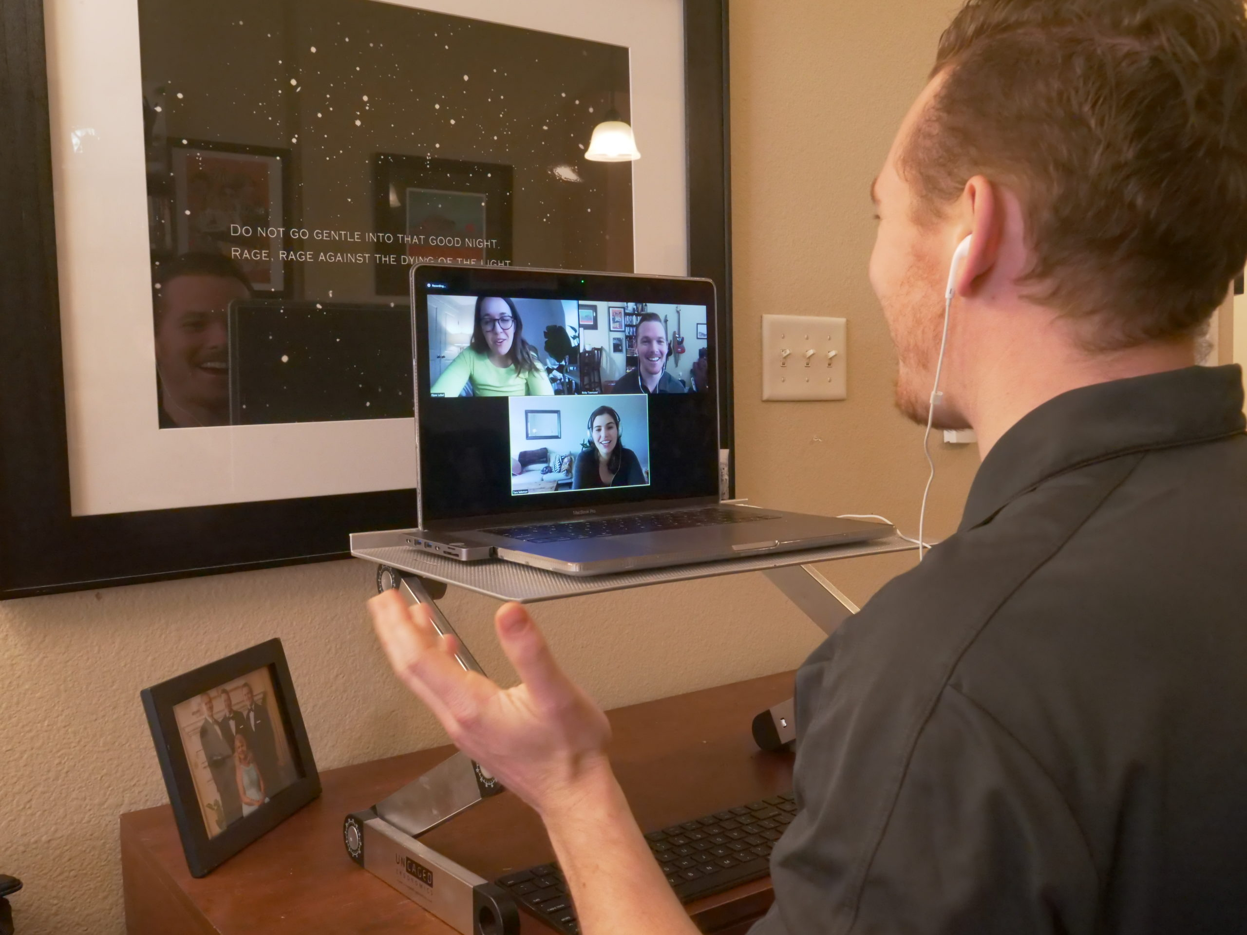 A Caucasian male chatting during a video conference call