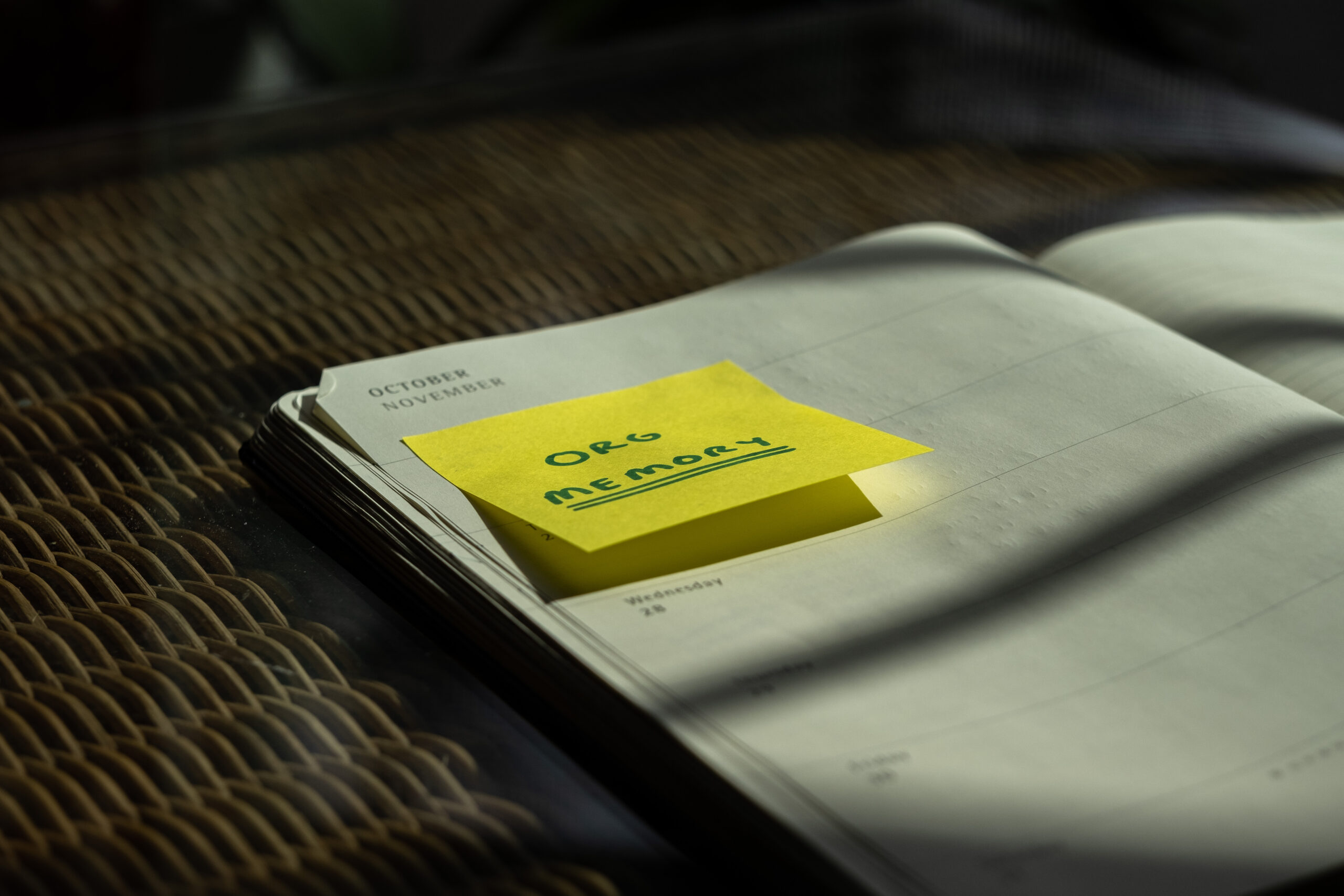 A notebook with a yellow sticky note
